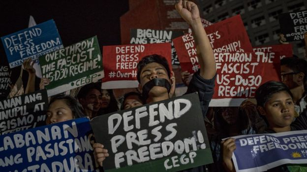 Journalists and activists stage a protest calling to defend press freedom on January 19, 2018