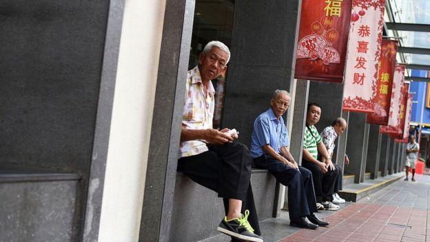 Trabalhadores aposentados em Cingapura