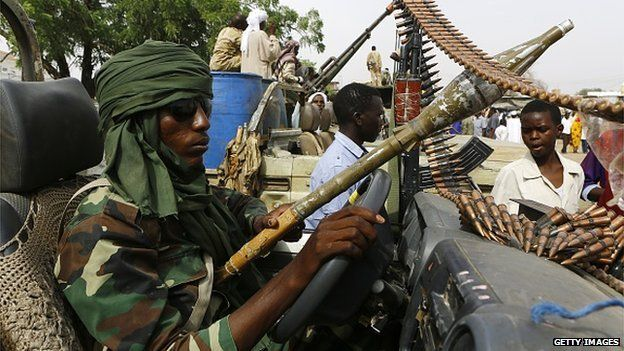 Sudanese forces display weapons and vehicles they say they captured from Dafuri rebels