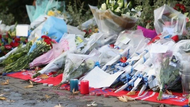 Floral tributes at tram derailment site