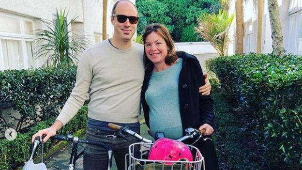 Julie Genter poses with her partner Peter and their bikes