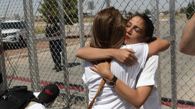 Alexandria Ocasio-Cortez is embraced at the Tornillo-Guadalupe port of entry gate on June 24, 2018 in Tornillo, Texas.