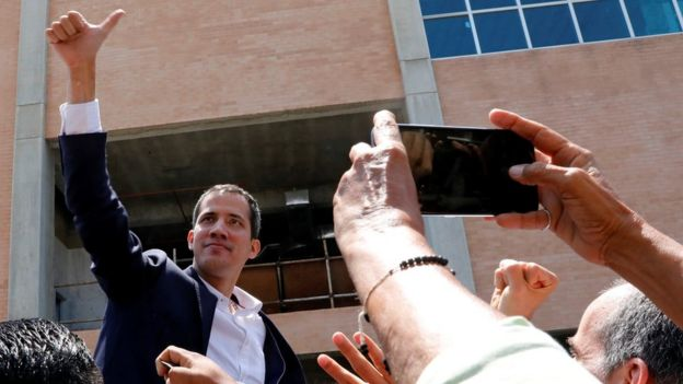 Venezuelan opposition leader Juan Guaidó greets supporters after his arrival at the Simón Bolivar International airport in Caracas, Venezuela March 4, 2019