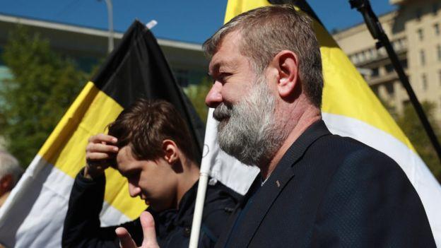 Вячеслав Мальцев с черно-желтым флагом