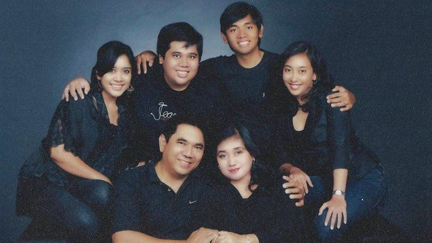 Aldi Haryopratomo with his parents and his brother and their wives