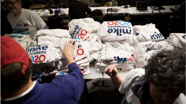 Supporters pick out t-shirts during a rally for Democratic presidential candidate former New York City Mayor Mike Bloomberg in Nashville, TN