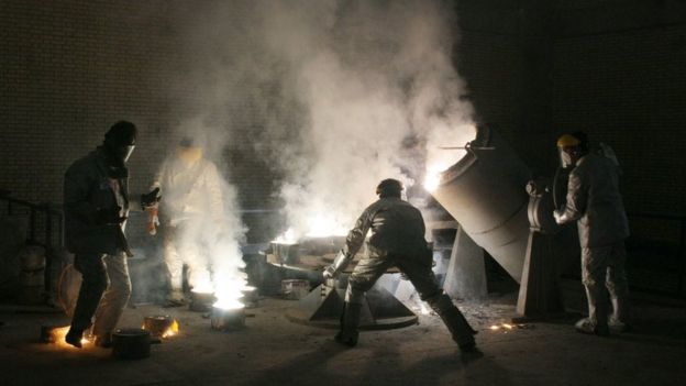 Workers at a uranium conversion facility on the outskirts of Isfahan, March 30, 2005