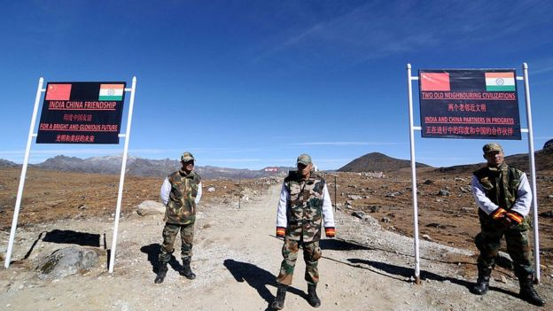 Indian Army personnel keep vigilance at Bumla pass at the India-China border in Arunachal Pradesh on October 21, 2012