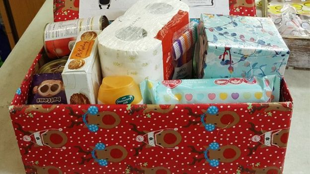 A decorated box full of household items and food