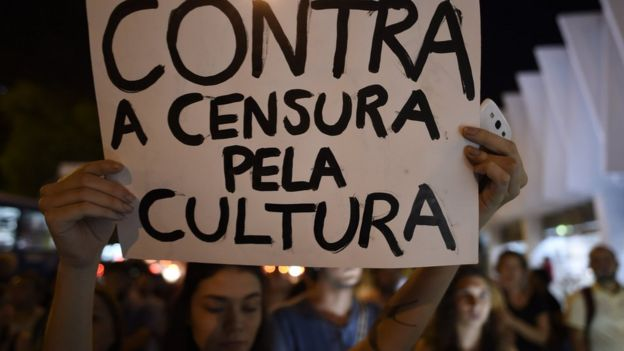 A demonstrator holds a sign 'Against censorship of culture' as artists and musicians gather at the Palacio das Artes during the 'Faca Voce Mesmo Sua Capela Sistina' (Make Your Own Sistine Chapel) exhibition by artist Pedro Moraleida, in Belo Horizonte, Brazil on October 9, 2017