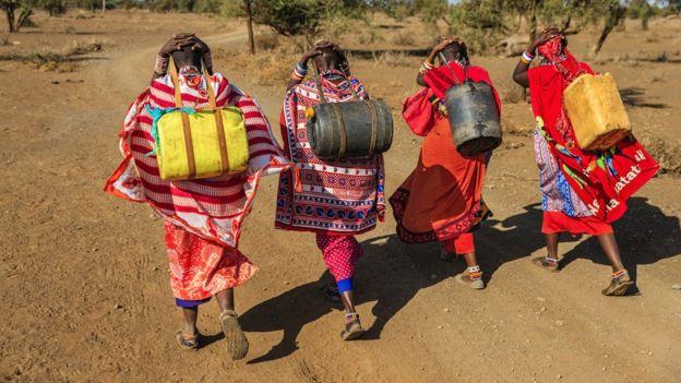Maasai women carrying water in Kenya