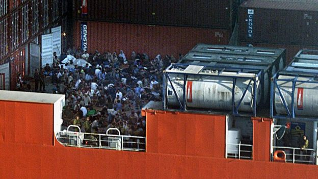 Asylum seekers crowd the deck of the MV Tampa in August 2001