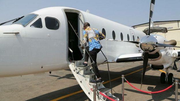 Prophet Shepherd Bushiri entering a plane