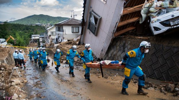 More than 70,000 emergency workers have been deployed across western Japan / AFP