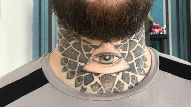 Louis James neck tattoo