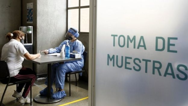 A woman takes a free test for Covid-19, at a metro station in Medellín, Colombia, 08 July 2020.