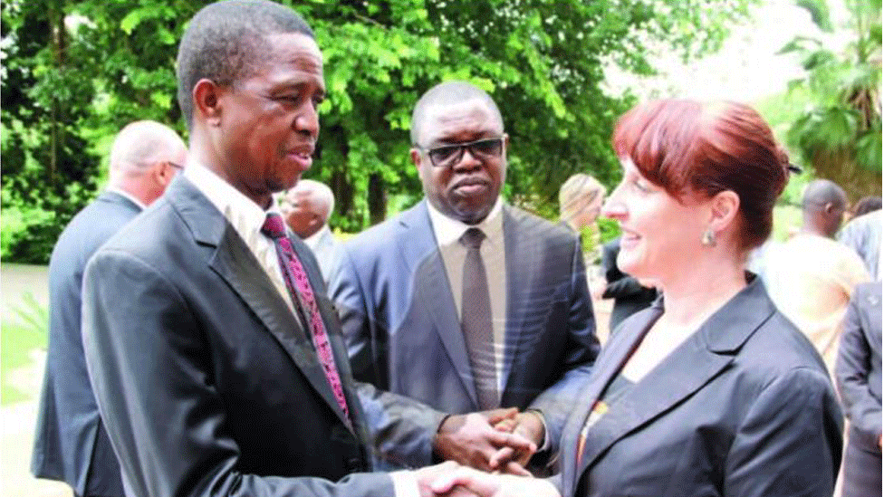 Zambia's President Edgar Lungu shakes hands with Pamela O'Donnell, Canada's High Commissioner to Zambia