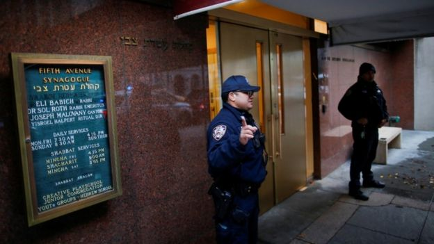 New York Police Department officers stand guard at Fifth Avenue Synagogue in New York, December 11, 2019