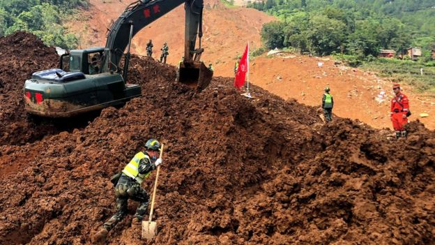 """Rescuers search for survivors at the site of a landslide in Liupanshui in China""""s southwestern Guizhou province"""