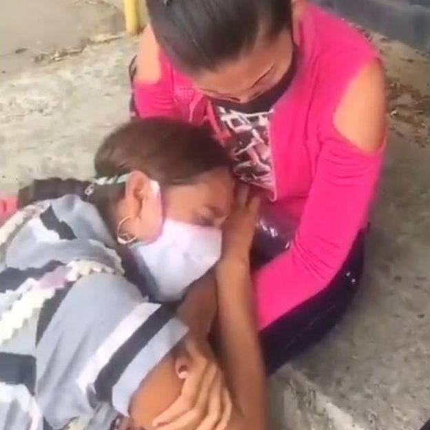 Two women wearing masks cry outside Los Llanos jail in Guanare, Venezuela, 2 May 2020)