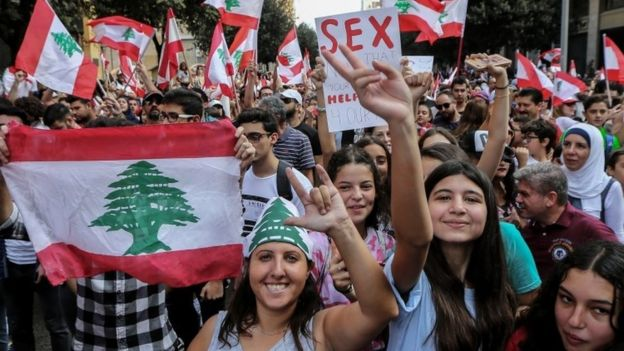 Protesters carry placards during a protest in front the Government palace in downtown Beirut, Lebanon
