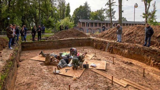 Archaeologists work at a site of the supposed burial place of French General Charles Etienne Gudin de la Sablonniere in Smolensk, Russia, 7 July 2019