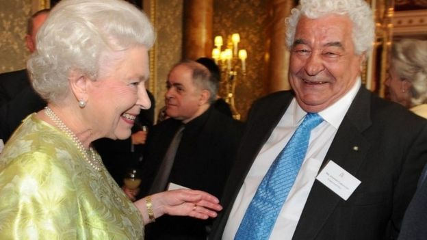 Queen Elizabeth II speaking with celebrity chef and restaurateur Antonio Carluccio