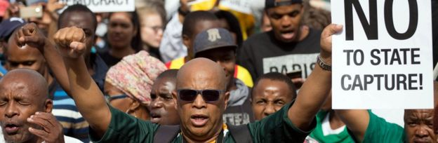 Demonstrators take part in a protest calling for the removal of South Africa