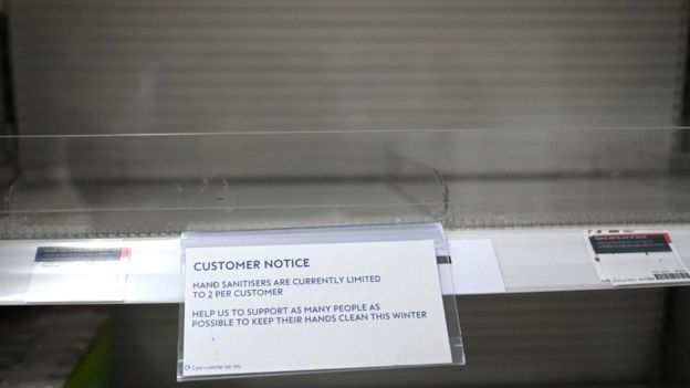 A sign for hand sanitisers is displayed on an empty shelf in a pharmacy in London, Britain, 05 March 2020