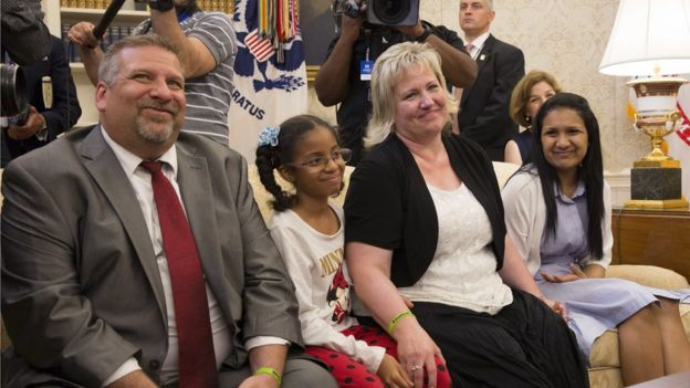 Joshua Holt's father Jason Holt, daughter Marian Leal, mother Laurie Holt and wife Thamara Candelo listen during a meeting with President Donald Trump at The White House on May 26, 2018
