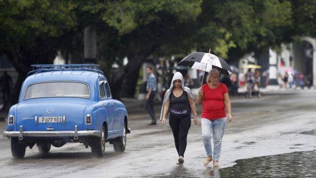 Cuban getting rained on