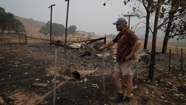 Travis assessing the damage on his farm