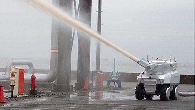 Robot water cannon truck firing jet of water
