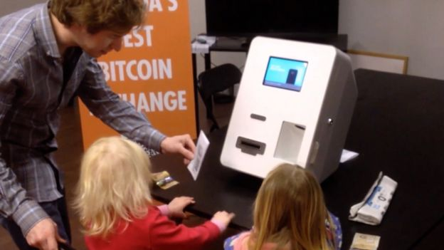 Gerald Cotten in 2014 showing Alex Salkeld's daughters how to use a Bitcoin automatic teller