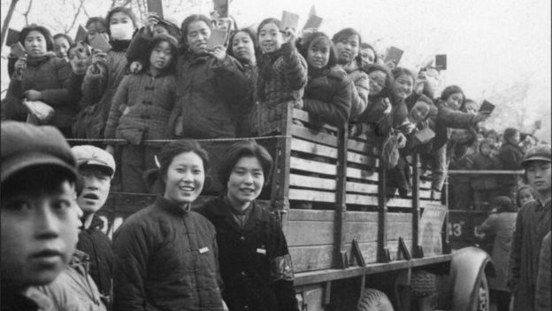 "Red Guards and Students display Mao""s ""Little Red Book"" during a parade in 1966."