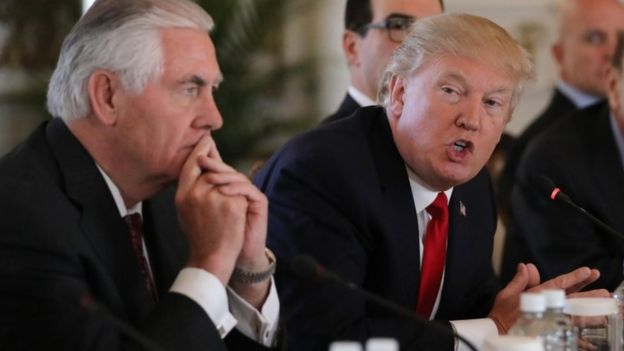 U.S. President Donald Trump (R) speaks next to Secretary of State Rex Tillerson during a bilateral meeting with China