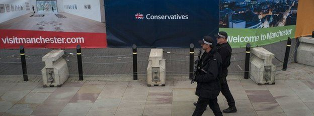 Police walk past Manchester central, the 2015 Conservative Party conference venue