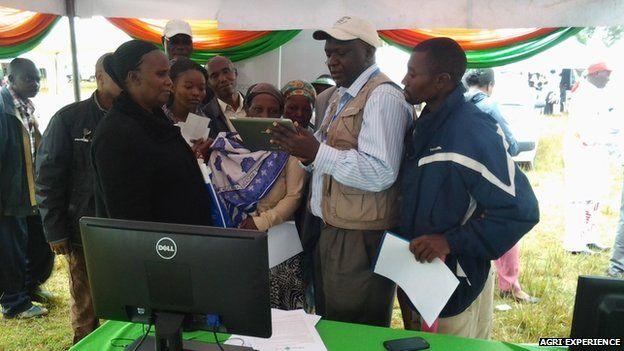 Farmers looking at an ipad