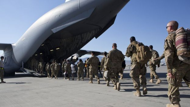 US soldiers walk to their C-17 cargo plane for departure May 11, 2013 at Bagram Air Base, Afghanistan