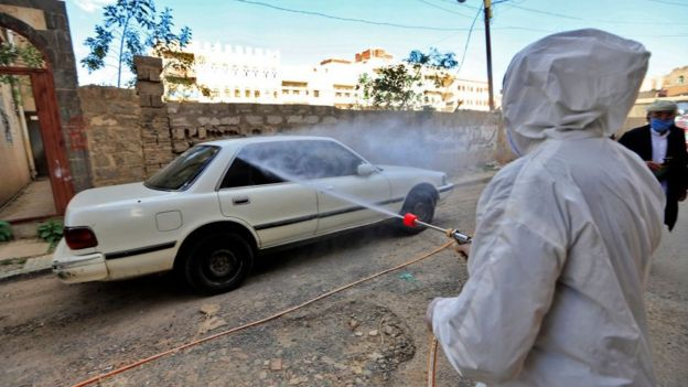 A car is disinfected in Yemen