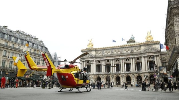An emergency medical helicopter waits at place de l'Opéra after an explosion at a bakery in nearby Rue de Trévise in Paris, France, on 12 January 2019