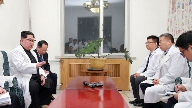 "This April 23, 2018 picture released by North Korea""s official Korean Central News Agency (KCNA) on April 24, 2018 shows North Korean leader Kim Jong-Un (L) speaking to Chinese Ambassador to North Korea Li Jinjun (2nd R) while visiting a hospital where Chinese tourists injured in a bus accident were being treated"