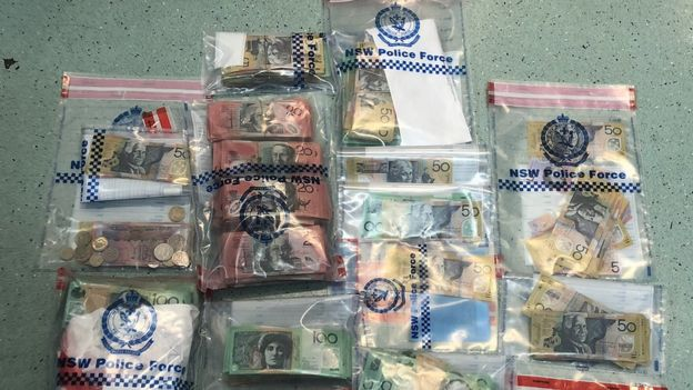 Clear plastic bags filled with Australian currency, alleged to be the proceeds of crime
