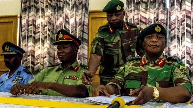Zimbabwe Army Gen Constantino Chiwenga, commander of the Zimbabwe Defence Forces (R), and Valerio Sibanda, commander of the Zimbabwe National Army address a media conference held at Zimbabwean army headquarters in Harare on Monday