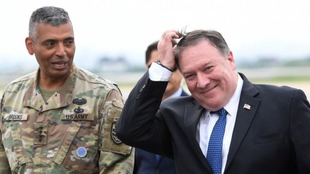 US Secretary of State Mike Pompeo, right, arrives in Seoul, 13 June 2018