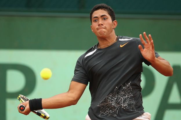 Karim Hossam plays a forehand during his boys' singles first round match against Liam Broady of Great Britain during day nine of the French Open at Roland Garros on June 4, 2012 in Paris
