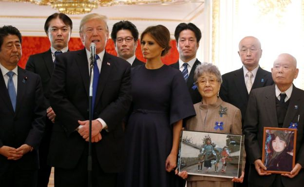 U.S. President Donald Trump speaks beside first lady Melania Trump and Japan's Prime Minister Shinzo Abe during a meeting with family members of Japanese citizens abducted by North Korea agents in the 1970s and 80s, at Akasaka Palace in Tokyo, Japan, 6 November 2017.