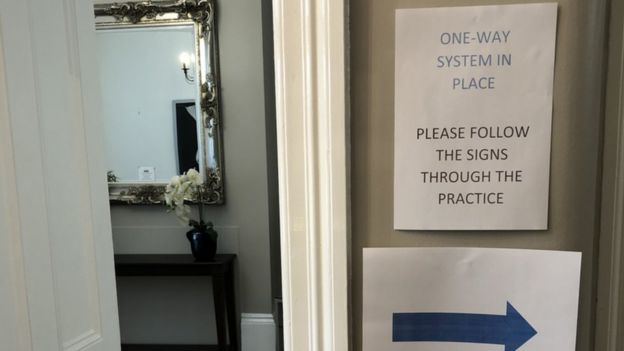 """Dental practice with sign on door saying """"one way system in place"""""""