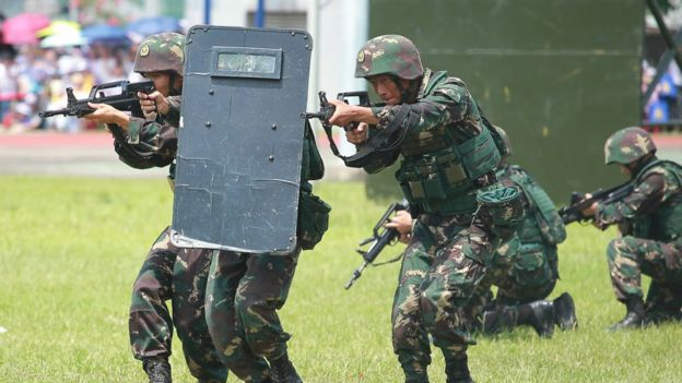Soldiers of the People's Liberation Army (PLA) perform drills at the PLA Ngong Shuen Chau Barracks in Hong Kong