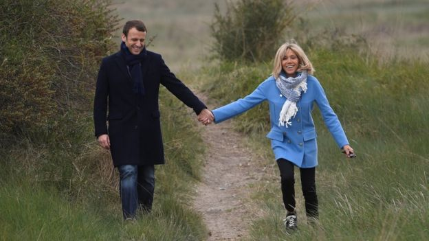 Emmanuel and Brigitte Macron posing for photographs during the presidential campaign
